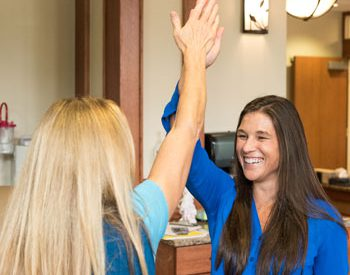 Two Valley View nurses giving high fives