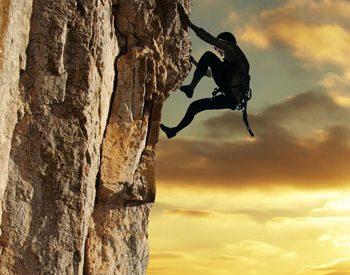 A rock climber during sunset