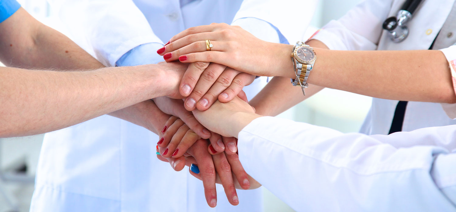 Doctors hands in a huddle