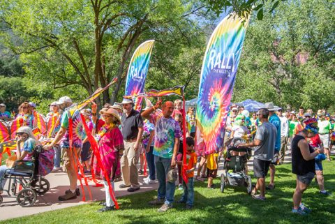 Rally the Valley crowds with tie dye rainbow signs