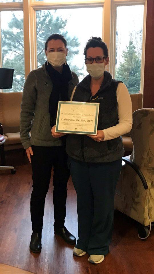 Emily Piper receiving her award