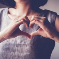 Woman holding her hands to form a heart