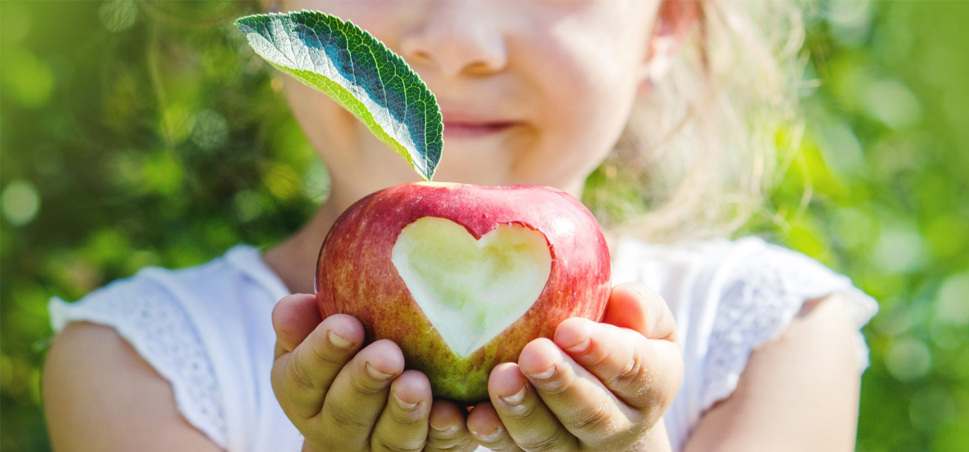 Girl with an apple with a heart