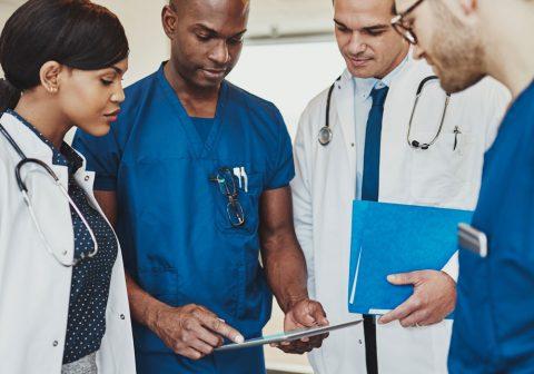 Doctors listening to another doctor speak